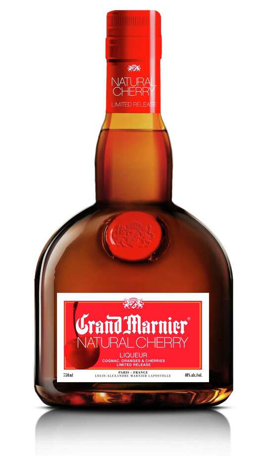 "Grand Marnier (GRAN mahr-NYAY):A Cognac-based liqueur with orange essence. Audio: Click here to hear the term ""Grand Marnier."" Photo: Grand Marnier"