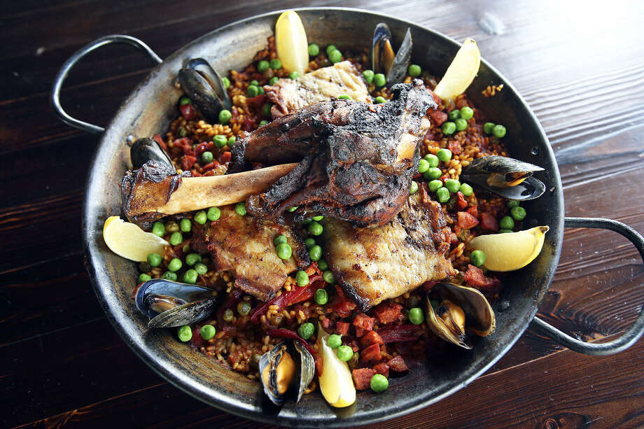 "Paella (pah-AY-yah):A Spanish dish of saffron rice with vegetables and meats, traditionally seafood. Audio: Click here to hear the term ""Paella."" Photo: Photos By Tom Reel / San Antonio Express-News"