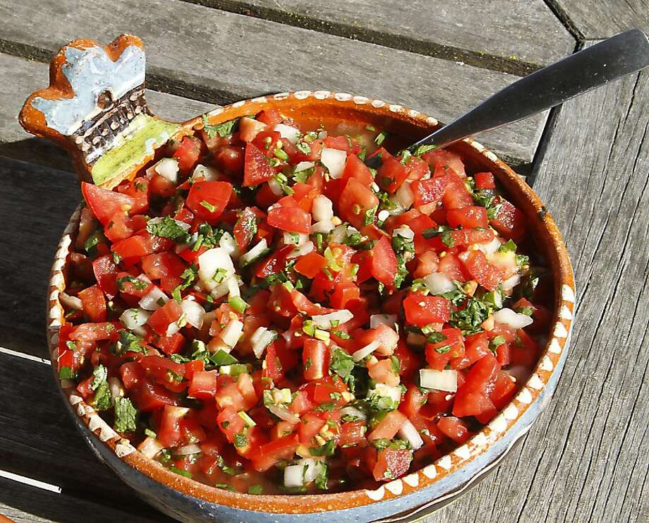 "Pico de gallo (PEE-koh deh GAH-yoh):A Spanish condiment of finely chopped tomatoes, onions, chiles, cilantro and citrus juice. Audio: Click here to hear the term ""Pico de gallo."" Photo: Robert McMahan"