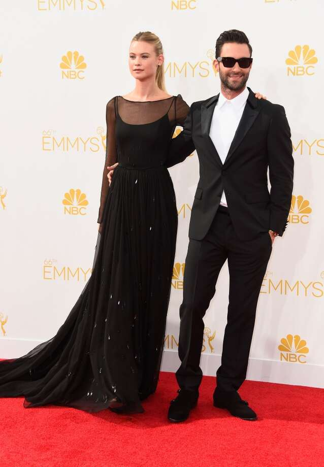 Model Behati Prinsloo (L) and singer Adam Levine attend the 66th Annual Primetime Emmy Awards held at Nokia Theatre L.A. Live on August 25, 2014 in Los Angeles, California. Photo: Frazer Harrison, Getty Images