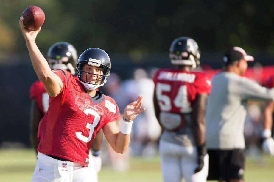 "Tom Savage, left, and Case Keenum are waging a friendly competition for the No. 2 quarterback spot behind Ryan Fitzpatrick, with Keenum saying, ""We're pulling for each other. We're all on the same team here."" Photo: Brett Coomer, Staff / © 2014 Houston Chronicle"