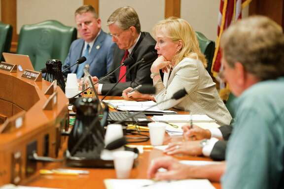 Members of a House subcommittee listen to testimony Monday in Austin about proposed rules concerning oil industry wastewater disposal and seismic activity in Texas.
