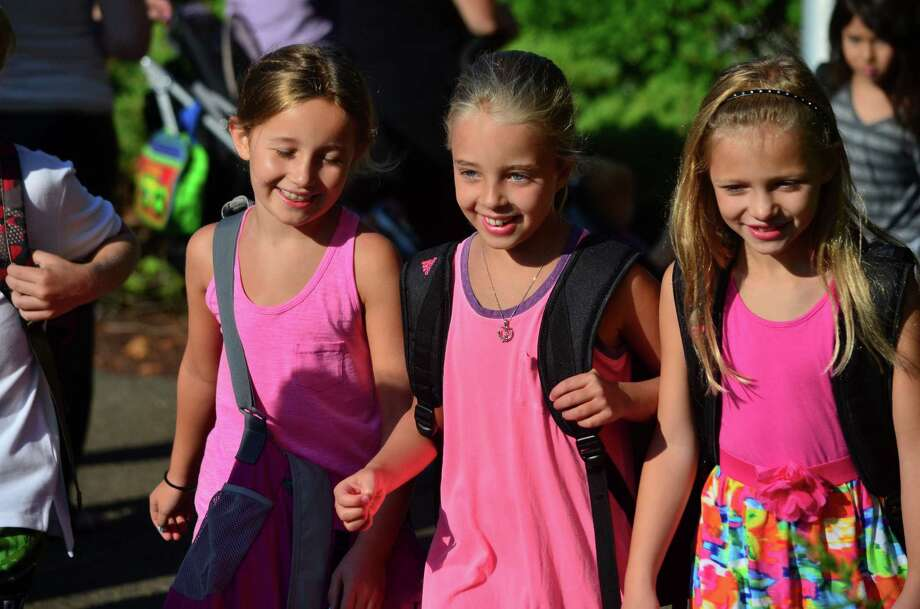 Royle Elementary School students walked with their respective classes during the Parade of Learners, a new tradition started this year. Parents line the driveway and applaud their children as they walk into the school for their first day of school. Photo: Megan Spicer / Darien News