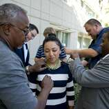 Carmen Rosales, 30, aunt of Nicky Dillon, 13, is miked by television media before speaking on behalf of Nicky who was injured in Sunday mornings earthquake in Napa, Calif. Dillon suffered multiple pelvic fractures when bricks dislodged from fireplace at home  and fell on him. He was too sick to meet with the media on Monday afternoon, August 25, 2014.