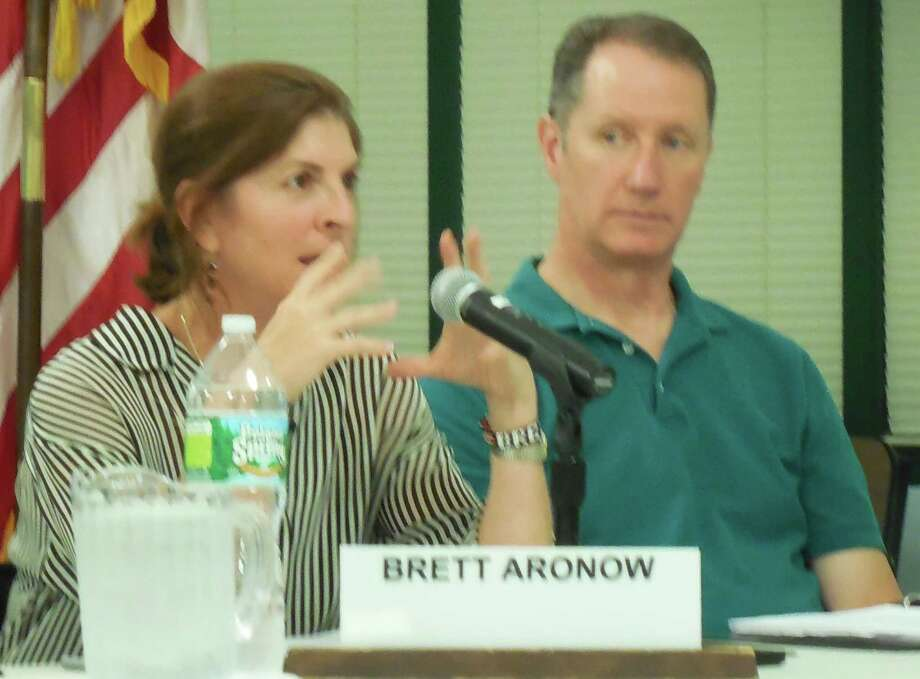 Board of Education member Brett Aronow, left, makes a point during Monday's meeting of the Board of Education. Looking on is fellow-BOE member Mark Mathias. Photo: Anne M. Amato / westport news