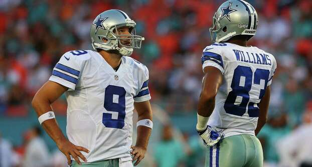 QB Tony Romo, wide receiver Terrance Williams and Dallas struggled to find their rhythm offensively Saturday in Miami. Romo, coming off back surgery, didn't practice Monday. Photo: Mike Ehrmann / Getty Images / 2014 Getty Images
