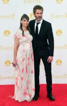 Actress Amanda Peet is expecting her third child with husband David Benioff. She unveiled her baby bump at the 2014 Emmy Awards.