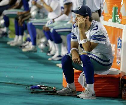 Dallas Cowboys quarterback Tony Romo (9) sits on the sidelines during the second half of an NFL preseason football game, Saturday, Aug. 23, 2014 in Miami Gardens, Fla. The Dolphins defeated the Cowboys 25-20. (AP Photo/Lynne Sladky) Photo: Lynne Sladky, Associated Press / AP