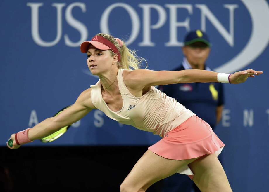 Maria Kirilenko of Russia returns to  Maria Sharapova of Russia during their US Open 2014 women's singles match at the USTA Billie Jean King National Center August 25, 2014  in New York. AFP PHOTO/Don EmmertDON EMMERT/AFP/Getty Images ORG XMIT: 507840207 Photo: DON EMMERT / AFP