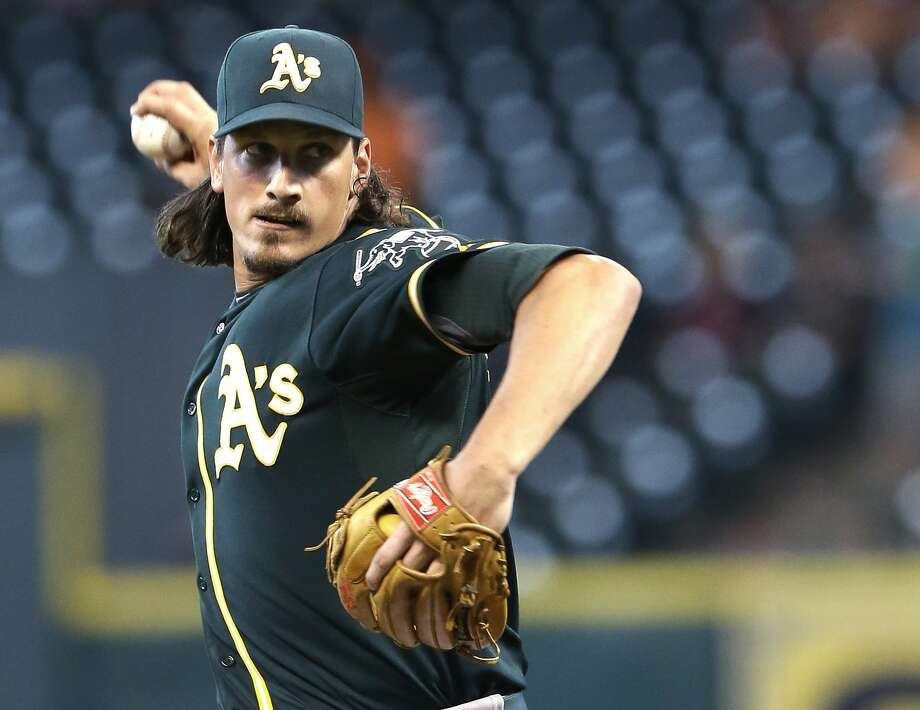 Oakland Athletics' Jeff Samardzija delivers a pitch against the Houston Astros in the first inning of a baseball game Monday, Aug. 25, 2014, in Houston. (AP Photo/Pat Sullivan) Photo: Pat Sullivan, Associated Press