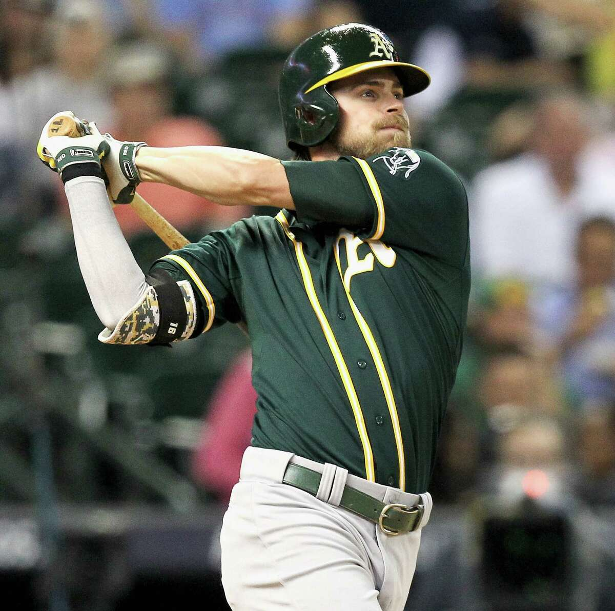 HOUSTON, TX - AUGUST 25: Josh Reddick #16 of the Oakland Athletics hits a home run against the Houston Astros in the fourth inning at Minute Maid Park on August 25, 2014 in Houston, Texas. (Photo by Bob Levey/Getty Images)