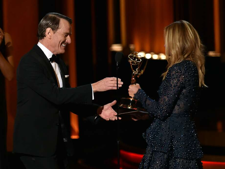"Bryan Cranston of ""Breaking Bad"" accepts his Emmy for outstanding lead actor in a drama series from Julia Roberts. Photo: Kevin Winter, Getty Images"