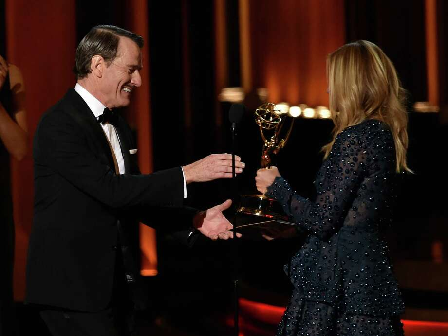 LOS ANGELES, CA - AUGUST 25:  Actor Bryan Cranston (L) accepts Outstanding Lead Actor in a Drama Series for 'Breaking Bad' from actress Julia Roberts onstage at the 66th Annual Primetime Emmy Awards held at Nokia Theatre L.A. Live on August 25, 2014 in Los Angeles, California.  (Photo by Kevin Winter/Getty Images) Photo: Kevin Winter, Staff / 2014 Getty Images