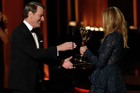 LOS ANGELES, CA - AUGUST 25:  Actor Bryan Cranston (L) accepts Outstanding Lead Actor in a Drama Series for 'Breaking Bad' from actress Julia Roberts onstage at the 66th Annual Primetime Emmy Awards held at Nokia Theatre L.A. Live on August 25, 2014 in Los Angeles, California.  (Photo by Kevin Winter/Getty Images)