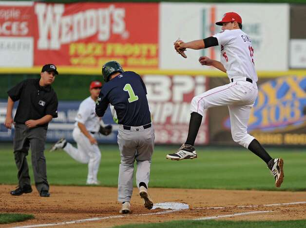 Tri-City ValleyCats first baseman Ricky Gingras jumps in the air to catch a wild throw but doesn't tag base runner Yairo Munoz in time during a baseball game against the Vermont Lake Monsters at Joe Bruno Stadium on Monday, Aug. 25, 2014 in Troy, N.Y. (Lori Van Buren / Times Union) Photo: Lori Van Buren / 00028302A