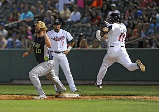 Tri-City ValleyCats' Jason Martin takes a long leap but is thrown out at first base during a baseball game against the Vermont Lake Monsters at Joe Bruno Stadium on Monday, Aug. 25, 2014 in Troy, N.Y. (Lori Van Buren / Times Union) Photo: Lori Van Buren / 00028302A