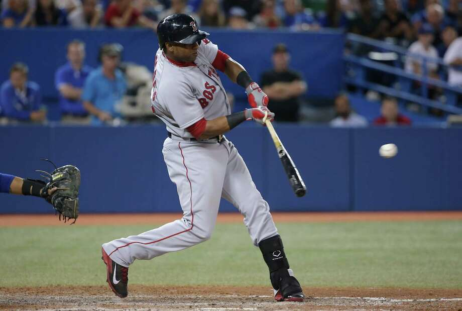 TORONTO, CANADA - AUGUST 25: Yoenis Cespedes #52 of the Boston Red Sox hits an RBI single in the tenth inning during MLB game action against the Toronto Blue Jays on August 25, 2014 at Rogers Centre in Toronto, Ontario, Canada. (Photo by Tom Szczerbowski/Getty Images) ORG XMIT: 477588671 Photo: Tom Szczerbowski / 2014 Getty Images