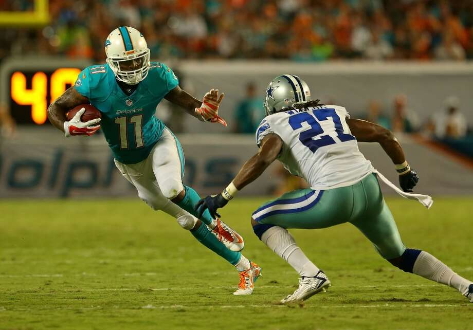 Avoid  Mike Wallace, WR, Miami Dolphins  (ESPN ADP: 90.7; Yahoo! ADP: 80.4) – We've seen this movie before: player out-plays his rookie contract in a major way, threatens a hold-out (or actually does), doesn't get what he wants, leaves and is never the same. Well, Wallace is well on his way to that unhappy Hollywood ending for those who keep drafting him high. After leaving the Steelers and their year-to-year commitment to a solid running game, Wallace found out first-hand just how tough it is for wideouts in Miami. QB Ryan Tannehill is likely to take a step forward this season, but the Dolphins are still a mess, they don't have other down-the-field options outside of TE Charles Clay, and they play in a division in the AFC East that is littered with shut-down defensive backs who are sure to make Wallace the focus of their attention. Again, there are plenty of safer options, if not ones with more upside than Wallace that can be had in his range or later. Photo: Mike Ehrmann, Getty Images