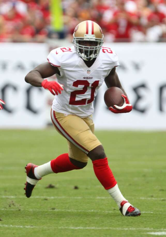Avoid  Frank Gore, RB, San Francisco 49ers  (ESPN ADP: 40.5; Yahoo! ADP: 68.4) A steady performer for several years running, Gore is on the wrong side of 30, and for fantasy drafters that can be a scary situation to stomach. The 49ers also added playmaker Stevie Johnson to an already formidable receiving corps, so that could mean less touches for Gore. Add in San Francisco's drafting of Carlos Hyde – regarded by many to be the best running back prospect in the 2014 draft – and there's even more reasons to believe that Gore won't be the workhorse he's been in years past. Photo: Marc Serota, Associated Press
