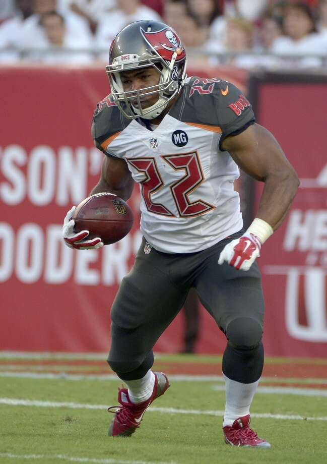 """Avoid  Doug Martin, RB Tampa Bay Buccaneers  (ESPN ADP: 16.6; Yahoo! ADP: 34.8) – The differences in ADPs between ESPN and Yahoo! should let you know that someone is likely to be very right while someone else is likely to be very angry come December. The problem with """"breakout stars"""" in fantasy football is that there's usually a reason they came out of nowhere, and there's usually just as much of a reason to believe that it won't last. The Bucs are a mess all around, although the addition of rookie WR Mike Wallace might help spread the field for Martin. Then again, if Wallace blows up then it could mean less touches for Martin. His injury issues from 2013 aside, Martin was having a very disappointing year prior to tearing his labrum and even his breakout 2012 campaign was helped immensely by one game: a 272-yard, 4-TD game. Again, show me it wasn't a fluke before I spend that high pick on you. Photo: Phelan M. Ebenhack, Associated Press"""