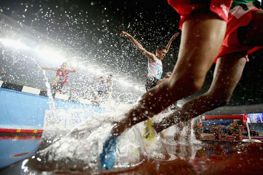NANJING, CHINA - AUGUST 25:  Ahmed Kenzi Saidia of Algeria (Center) competes in Men's 2000m Steeplechase Final of Nanjing 2014 Summer Youth Olympic Games at the Nanjing Olympic Sports Centre on August 25, 2014 in Nanjing, China.  (Photo by Feng Li/Getty Images) *** BESTPIX *** Photo: Feng Li, Getty Images