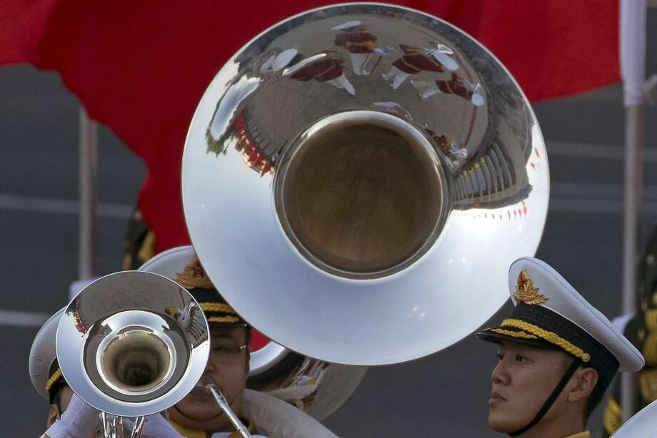 A military band performs during a welcome ceremony for Zimbabwe's President Robert Mugabe outside the Great Hall of the People in Beijing, China, Monday, Aug. 25, 2014. (AP Photo/Ng Han Guan) Photo: Ng Han Guan, Associated Press