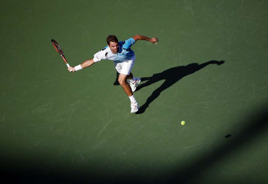 Stan Wawrinka, of Switzerland, chases down a shot by Jiri Vesely, of the Czech Republic, during the opening round of the 2014 U.S. Open tennis tournament, Monday, Aug. 25, 2014, in New York. (AP Photo/Elise Amendola) Photo: Elise Amendola, Associated Press