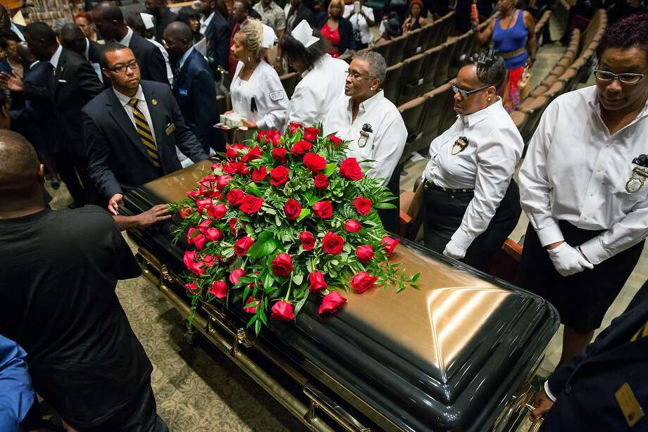 A casket containing the body of Michael Brown is wheeled out Monday, Aug. 25, 2014, at Friendly Temple Missionary Baptist Church in St. Louis. Hundreds of people gathered to say goodbye to Brown, who was shot and killed by a Ferguson, Mo., police officer on Aug. 9. (AP Photo/New York Times, Richard Perry, Pool) Photo: Richard Perry, Associated Press