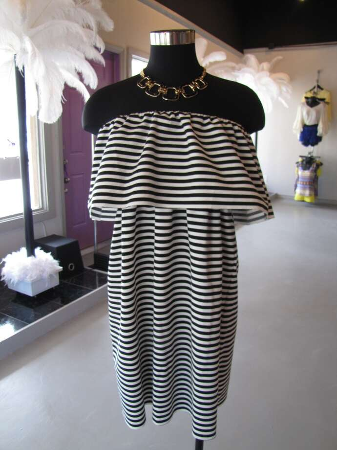 Black and white ruffle dress, $38.50; Black square necklace, $13. The Purple Door, Nederland Photo: Larena Head/cat5