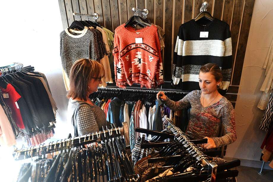 Hamshire Fannett student Amber Showers, right, and her mother shop during Black Friday at The Purple Door clothing store. Michael Rivera/@michaelrivera88