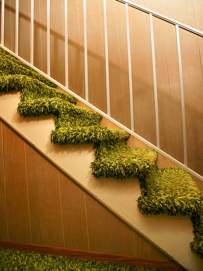 Stairway and railing-- is it carpet? Moss? Photo: HGTV Photo: Ron