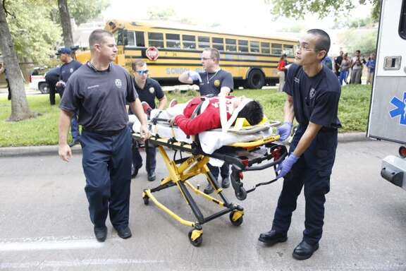 Fourteen people were rushed to the hospital after a school bus was involved in a traffic crash in west Houston.