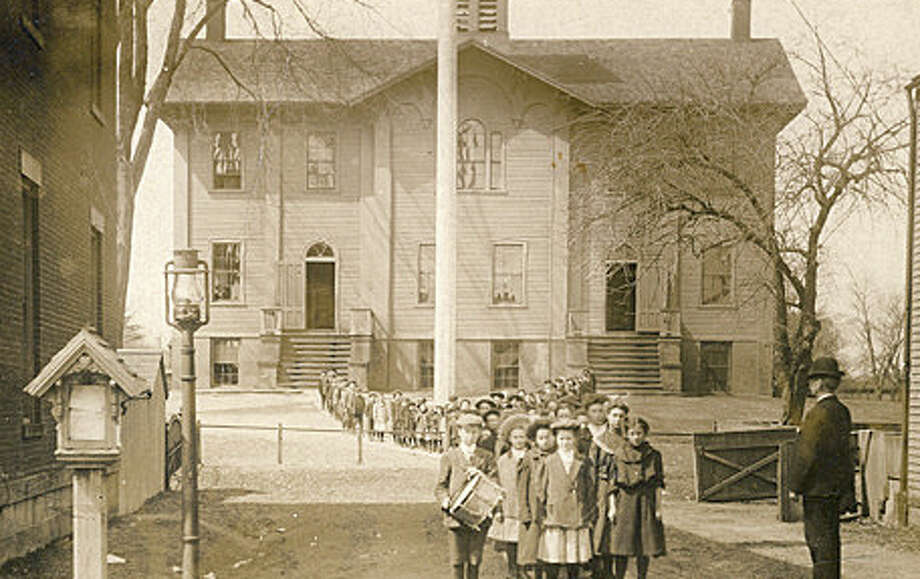 This postcard image of Pequot School in Southport shows a wooden building built in 1854 and replaced in 1918 by a brick building. The school stood vacant for several years after the town closed Pequot School in 1960. The school was purchased and re-opened as Eagle Hill School, a private school for children with learning disabilities. Courtesy: Fairfield Museum and History Center. Photo: Contributed Photo / Fairfield Citizen