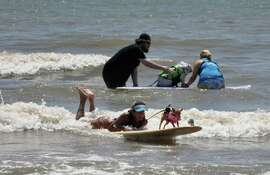 26 dogs to to their boards at the cry of Surf's Up Sunday.  Galveston Island Human Society say they hope they can make the event an annual extravaganza with beach side games for kids added too.