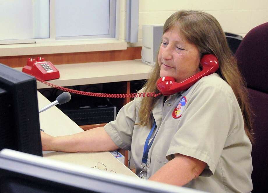 Conroe ISD Police Department emergency telecommunications specialist Lisa Dunham logs a Kid Chat tip at the CISD Police Station, 2900 N. Loop 336 East in Conroe. Photo: David Hopper, Freelance / freelance