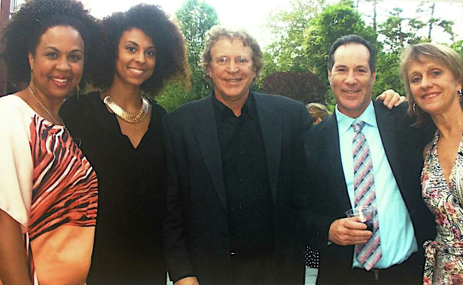 "Janelle Robinson, far left, won the ""Outstanding Featured Actress in a Musical"" award from the Connecticut Critics Circle for her role as Bloody Mary in the Summer Theatre of New Canaan's 2013 production of ""South Pacific."" With her, from left, her daughter, Alita Moses; STONC Executive Director Ed Libonati; Doug Shankman, who was nominated for outstanding choreographer; and STONC Artistic Director Melody Libonati. Photo: Contributed Photo, Contributed / New Canaan News Contributed"