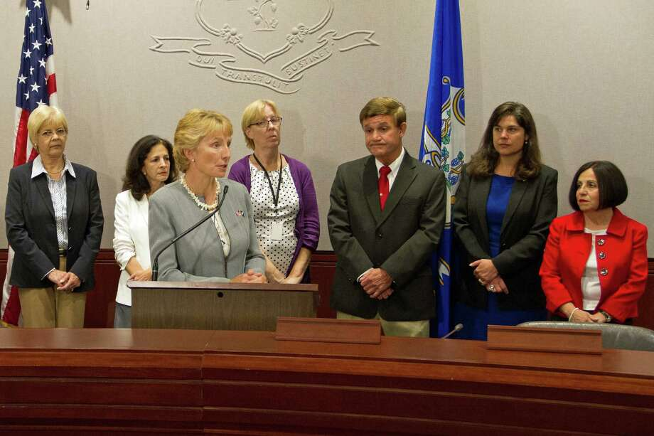 From left, Rep. Tami Zawistowki, Rep. Gail Lavielle, Rep. Pam Sawyer, Sen. Cathy Osten, Rep. Bill Aman, Sen. Dante Bartolomeo and Sen. Toni Boucher raise awareness about ConnecticutâÄôs safe havens law. Photo: Contributed Photo, Contributed / New Canaan News Contributed