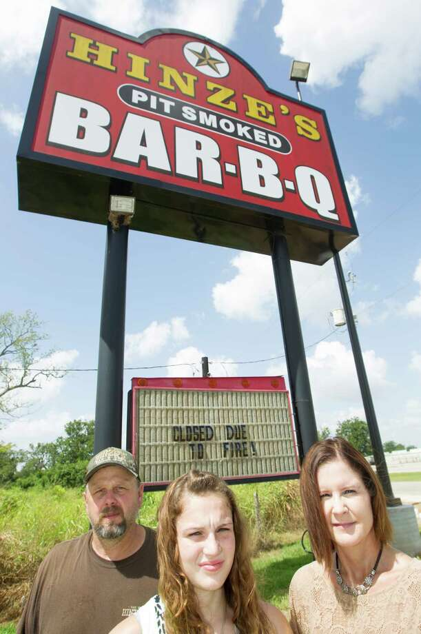Michael Hinze his daughter Libby, 17, and wife Terry pose for a portrait at their Bar-B-Que restaurant on Friday, Aug. 22, 2014, in Wharton. ( J. Patric Schneider / For the Chronicle ) Photo: J. Patric Schneider, Freelance / © 2014 Houston Chronicle