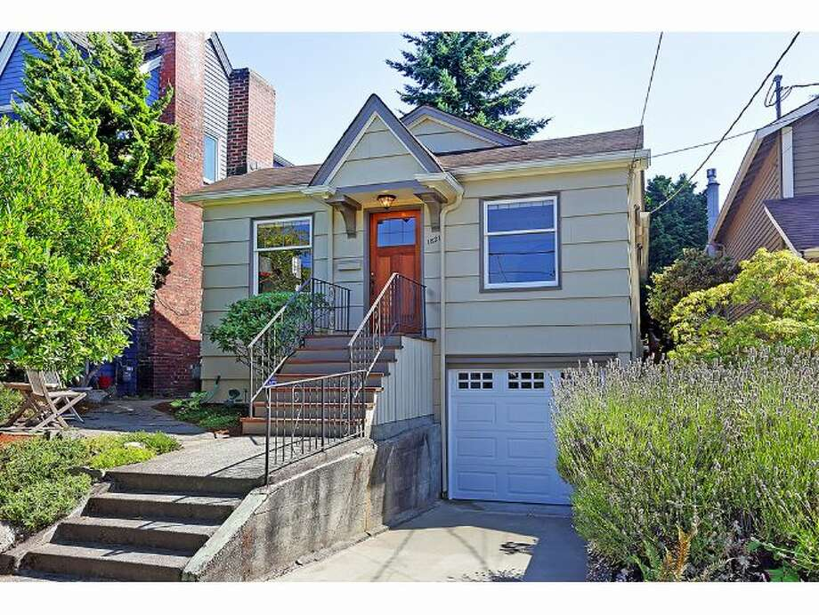 We'll start with the lowest-priced home on our tour, 1821 N. 51st St., which is listed for $630,000. The 1,820-square-foot house, built in 1928, has three bedrooms, full and three-quarter bathrooms, a family room, exposed wood moldings, built-ins, coved ceilings and a patio on a 3,210-square-foot lot. Photo: Courtesy Tom Bernard/Windermere Real Estate