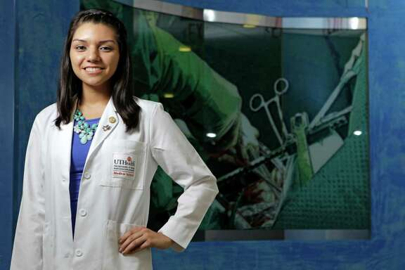 Claudia Martinez poses at UTHealth Medical School. She has had three brain operations for a condition called Chiari Malformation, in which the brain presses on the spinal column.  ( Melissa Phillip / Houston Chronicle )