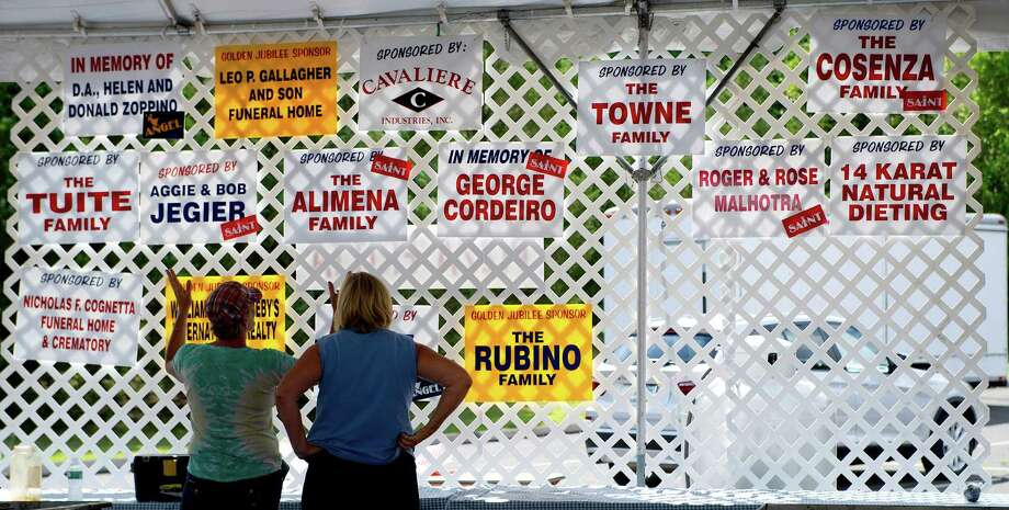 Volunteers help prepare for the St. Leo's Fair in Stamford, Conn., on Saturday, August 23, 2014. Photo: Lindsay Perry / Stamford Advocate