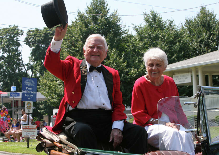 1960 Ringmaster Kenneth Maloney Sr. waves during the 64th annual Barnum Festival Great Street Parade in Bridgeport, Conn. in 2012.  Maloney, a World War II veteran, died Saturday, Aug 23, 2014 at age 92. Photo: B.K. Angeletti / Connecticut Post