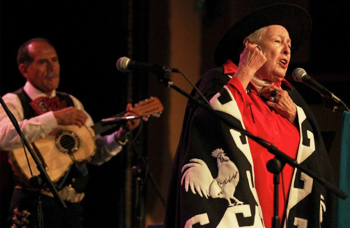 Janet Cortez, a member of the quartet Las Tesoros de San Antonio, performs at the 90th birthday celebration for Rita Vidaurri.