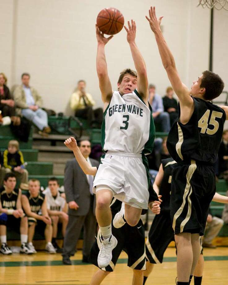 New Milford's John Krafick (3) puts up a shot over Joel barlow's Nelson Diaz during an SWC game Friday night at New Milford High. Photo: Barry Horn / The News-Times Freelance