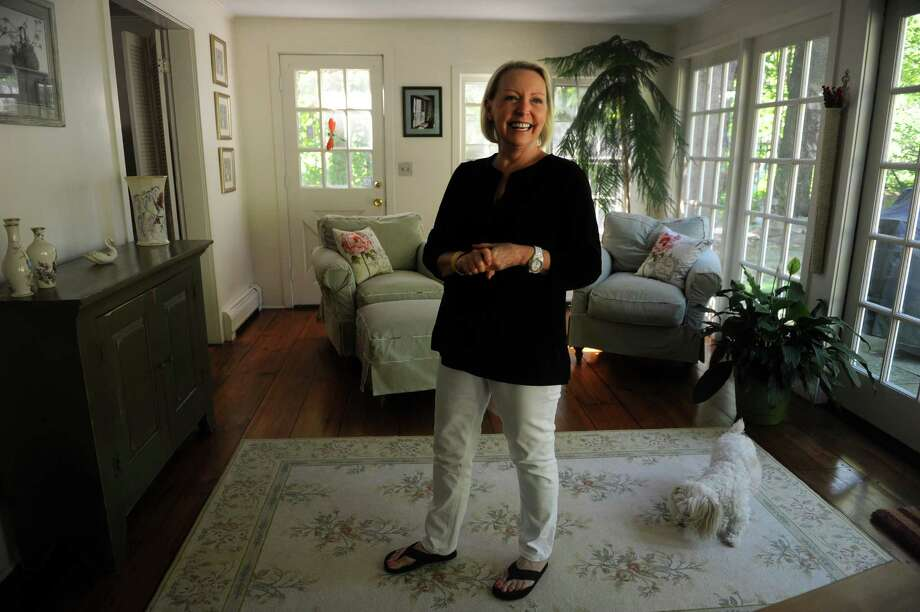 Owner Linda Raftery stands in the sun room of the historic former home of Rose Wilder Lane, daughter of Laura Ingals Wilder, at 23 King Street in Danbury. The house is currently for sale. Photo: Autumn Driscoll / Connecticut Post