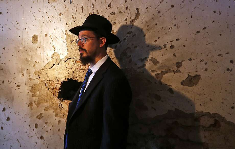 Rabbi Moshe Gourarie looks at a room riddled with bullet marks from the 2008 terror attack  at the Chabad center. He said the center's reopening should be seen as a message to the world. Photo: Rajanish Kakade, Associated Press