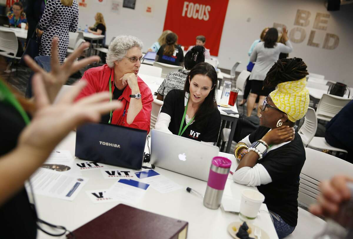 Diane Reppun of Los Gatos (l to r) brainstorms her idea with Carly DaCosta of San Francisco and Ardrina Hoxey of Oakland during the first Women-VetsinTech hackathon at Facebook on Monday, August 25, 2014 in Menlo Park, Calif.