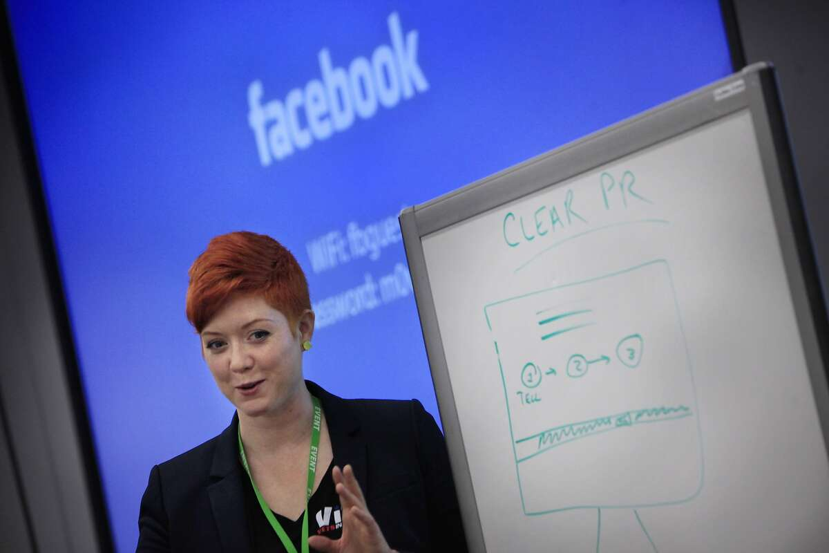 Lydia Davey, founder Moriah Creatives PR, brainstorms her idea for Clear PR with a group of attendees to the first Women-VetsinTech hackathon at Facebook on Monday, August 25, 2014 in Menlo Park, Calif.