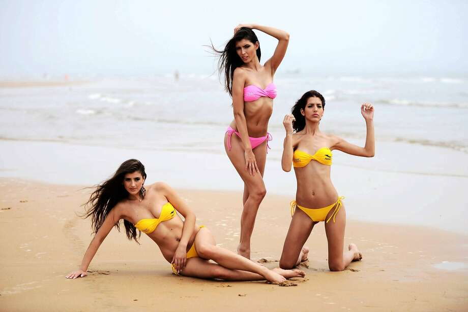 China eagerly awaits bikini showdown:Finalists in the 2014 OMC World Bikini Model Contest work on their beach moves in Qingdao, China. The final round of the contest begins Thursday. Photo: Stringer, AFP/Getty Images