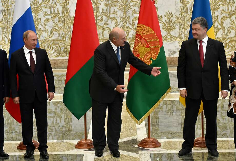 Russian President Vladimir Putin (left), Belarus President Alexander Lukashenko  and Ukrainian President Petro Poroshenko meet in the Belarusian capital of Minsk. Photo: Kirill Kudryavtsev, AFP/Getty Images
